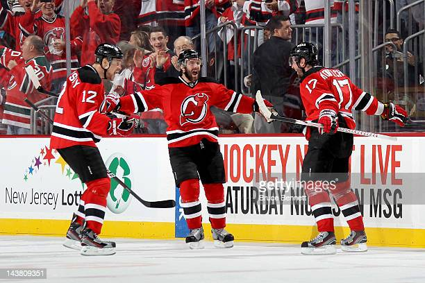 Ilya Kovalchuk of the New Jersey Devils celebrates with his teammates on the bench after scoring a goal in first period against Ilya Bryzgalov of the...