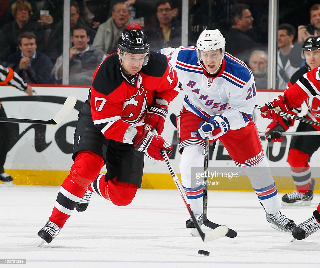 Ilya Kovalchuk #17 of the New Jersey Devils controls the puck while being pursued by Derek Stepan #21 of the New York Rangers during the game at the Prudential Center on February 5, 2013 in Newark, New Jersey.