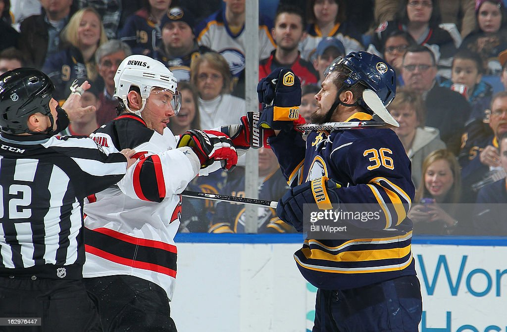 Ilya Kovalchuk #17 of the New Jersey Devils gets his stick up against Patrick Kaleta #36 of the Buffalo Sabres on March 2, 2013 at the First Niagara Center in Buffalo, New York. Buffalo defeated New Jersey, 4-3.