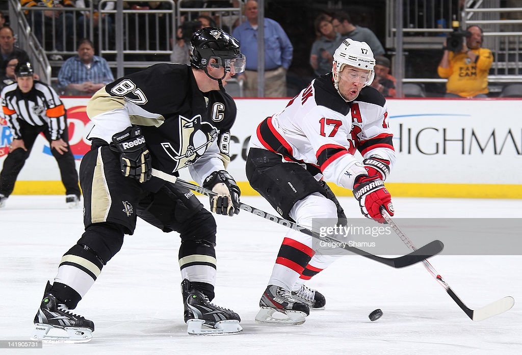 Ilya Kovalchuk #17 of the New Jersey Devils moves the puck in front of Sidney Crosby #87 of the Pittsburgh Penguins on March 25, 2012 at Consol Energy Center in Pittsburgh, Pennsylvania.
