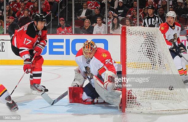 Ilya Kovalchuk of the New Jersey Devils puts the puck into the back of the net past Jacob Markstrom of the Florida Panthers for the gamewinning goal...