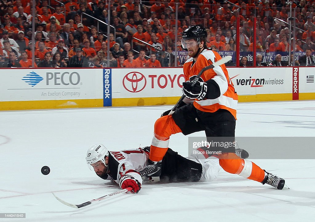 Ilya Kovalchuk #17 of the New Jersey Devils reaches to push the puck away from Sean Couturier #14 of the Philadelphia Flyers in Game Five of the Eastern Conference Semifinals during the 2012 NHL Stanley Cup Playoffs at Wells Fargo Center on May 8, 2012 in Philadelphia, Pennsylvania.