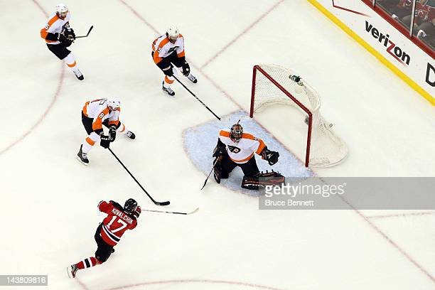 Ilya Kovalchuk of the New Jersey Devils scores a goal in the first period against Ilya Bryzgalov of the Philadelphia Flyers in Game Three of the...