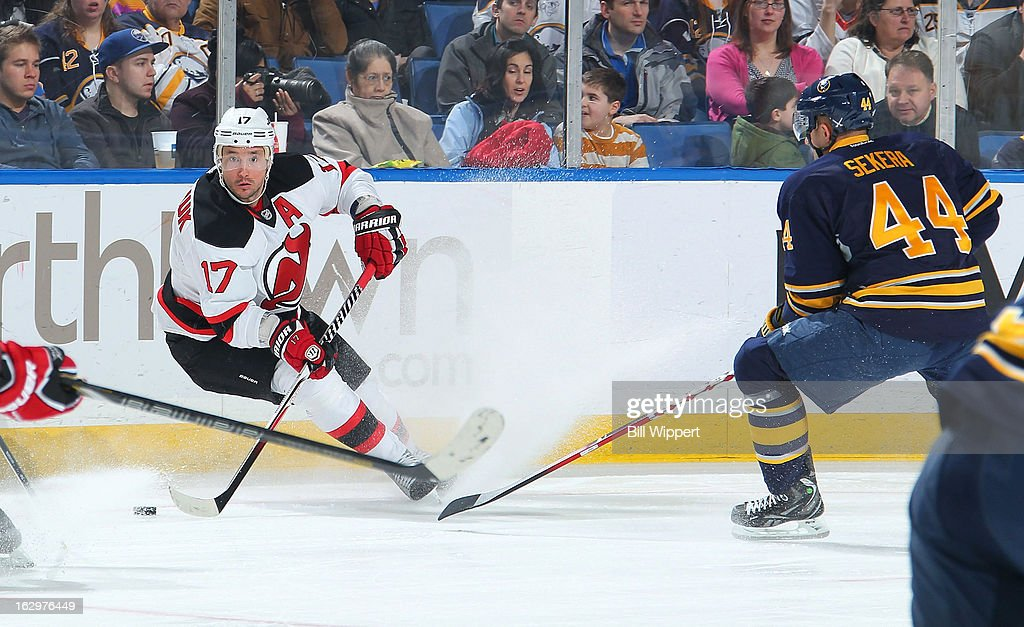 Ilya Kovalchuk #17 of the New Jersey Devils stops with the puck against Andrej Sekera #44 of the Buffalo Sabres on March 2, 2013 at the First Niagara Center in Buffalo, New York.