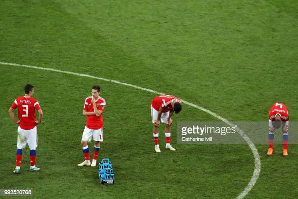 Ilya Kutepov Daler Kuziaev Aleksandr Erokhin and Sergey Ignashevich of Russia show their dejection following the defeat in the 2018 FIFA World Cup...