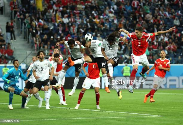 Ilya Kutepov of Russia wins a header over Mohamed Elneny Abdalla Said and Marwan Mohsen of Egypt during the 2018 FIFA World Cup Russia group A match...