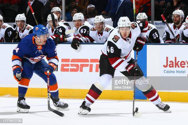 Ilya Lyubushkin of the Arizona Coyotes is defended by Cole Bardreau of the New York Islanders during the first period at NYCB Live's Nassau Coliseum...
