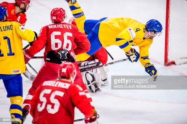 Ilya Mikheyev of Russia and Mattias Ekholm of Sweden vie during the group A match Russia v Sweden of the 2018 IIHF Ice Hockey World Championship at...