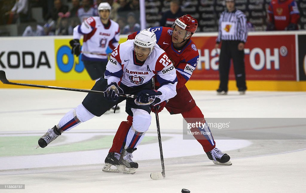 Ilya Nikulin (R) of Russia and Marcel Rodman (L) of Slovenia battle for the puck during the IIHF World Championship group A match between Russia and Slovenia at Orange Arena on May 1, 2011 in Bratislava, Slovakia.