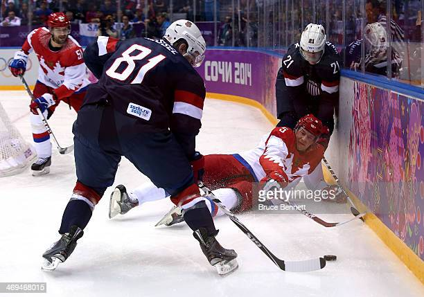Ilya Nikulin of Russia falls to the ice against Phil Kessel and James van Riemsdyk of United States during the Men's Ice Hockey Preliminary Round...