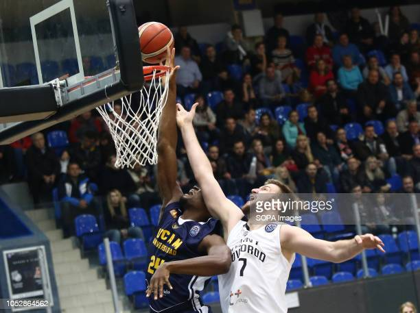 Ilya Popov and Kevin Tumba seen in action during the game Basketball Champions League BC Nizhny Novgorod from Russia vs Ucam Murcia Club Baloncesto...