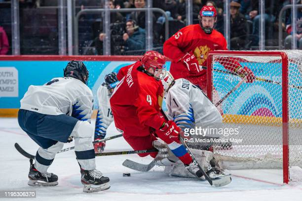 Ilya Rogovski of Russian Federation clashes with Goalkeeper Dylan Silverstein of United States during Men's 6Team Tournament Gold Medal Game between...