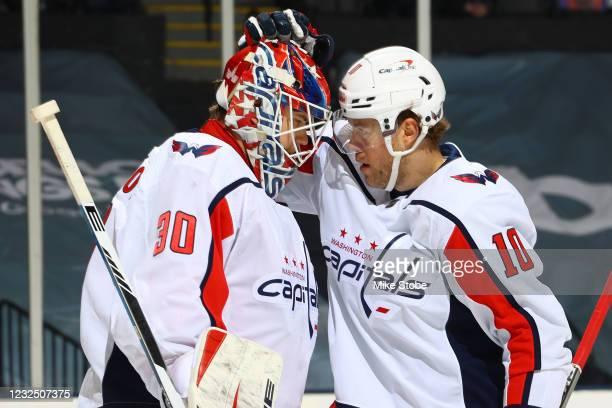 Ilya Samsonov and Daniel Sprong of the Washington Capitals celebrate the teams 6-3 victory against the New York Islanders at Nassau Coliseum on April...