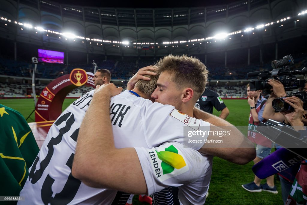 Ilya Zhigulev and Pavel Pogrebnyak of FC Tosno celebrate after winning the Russian Cup Final match between FC Tosno and Fc Avangard at Volgograd Arena on May 9, 2018 in Volgograd, Russia.