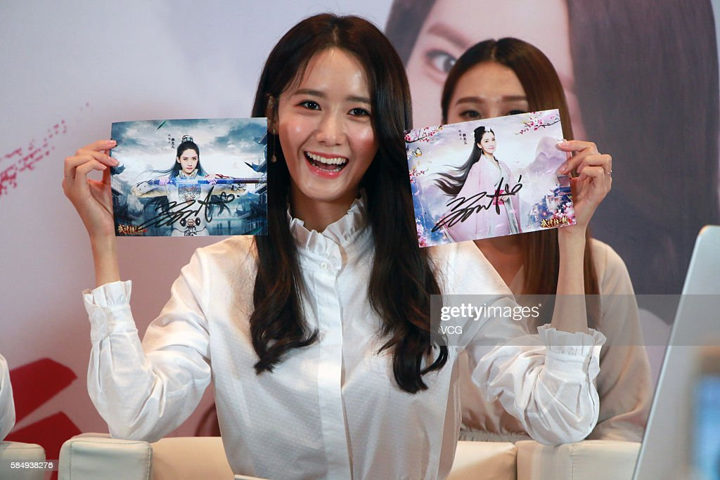 Im yoona visits shanghai photos and images getty images im yoona of south korean girl group girls generation meets fans on july 31 voltagebd Images