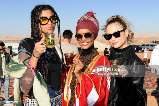 Imaan Hammam Halima Aden and Rose Bertram attend the Sounds Of The Sands Desert Trip during the MDL Beast Festival on December 20 2019 in Riyadh...