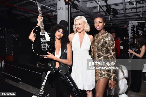 Imaan Hammam Karlie Kloss and Maria Borges at the 2017 amfAR The Naked Heart Foundation Fabulous Fund Fair at the Skylight Clarkson Sq on October 28...
