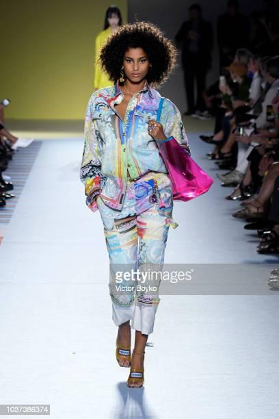 Imaan Hammam walks the runway at the Versace show during Milan Fashion Week Spring/Summer 2019 on September 21 2018 in Milan Italy