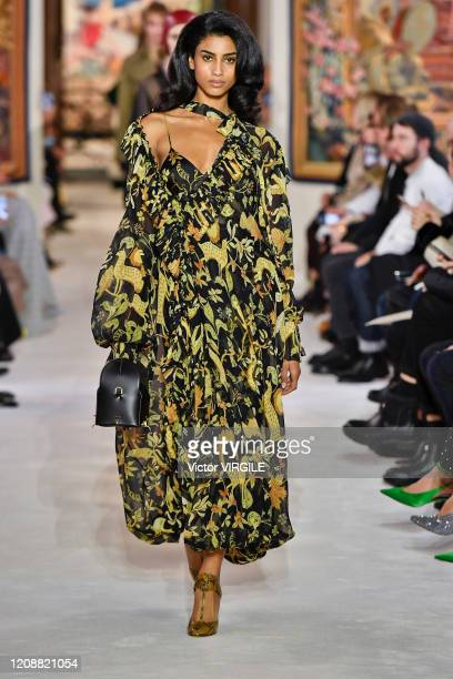 Imaan Hammam walks the runway during the Lanvin Ready to Wear fashion show as part of the Paris Fashion Week Womenswear Fall/Winter 2020/2021 on...