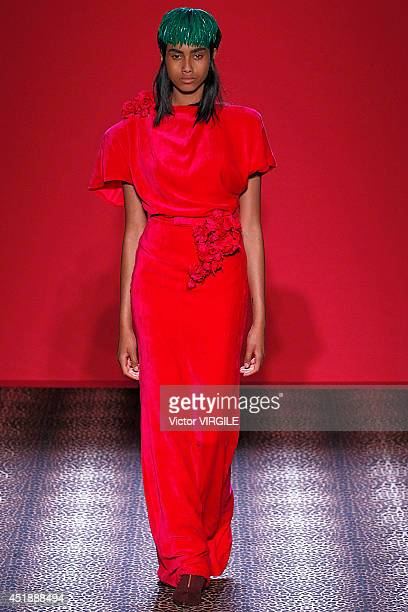 Imaan Hammam walks the runway during the Schiaparelli show as part of Paris Fashion Week Haute Couture Fall/Winter 20142015 on July 7 2014 in Paris...