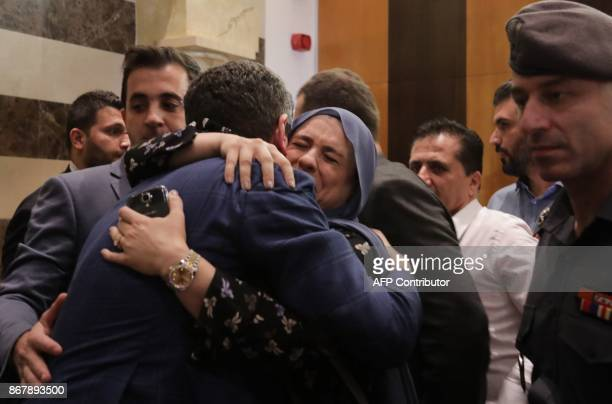 Imad alKhatib one of the three Lebanese nationals kidnapped in the Iraqi capital Baghdad last week is greeted by relatives upon his arrival in Beirut...