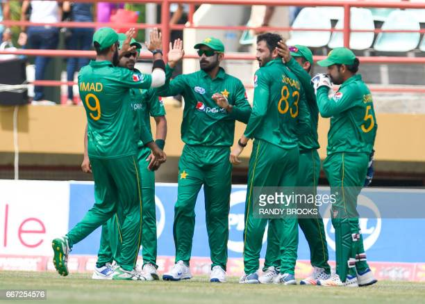 Imad Wasim Mohammad Hafeez Junaid Khan and Sarfraz Ahmed of Pakistan celebrate the dismissal of Evin Lewis of West Indies during the 3rd and final...