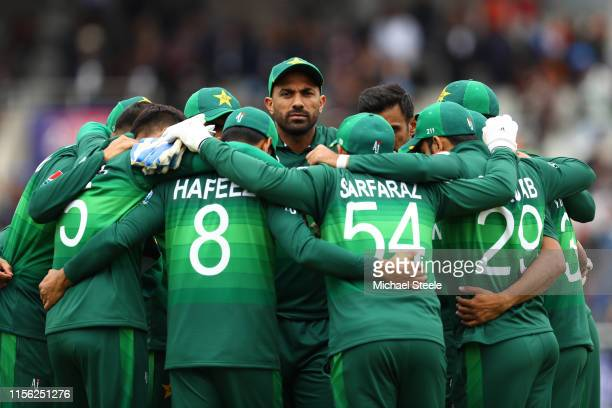 Imad Wasim of Pakistan and team mates in ahuddle ahead of play during the Group Stage match of the ICC Cricket World Cup 2019 between India and...