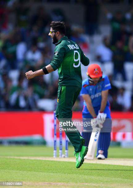 Imad Wasim of Pakistan celebrates the wicket of Rahmat Shah of Afghanistan during the Group Stage match of the ICC Cricket World Cup 2019 between...