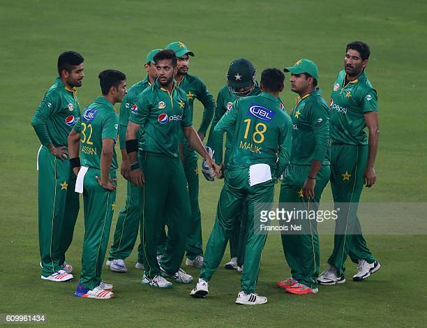 Imad Wasim of Pakistan celebrates with team mates during the first T20 International match between Pakistan and West Indies at Dubai International...