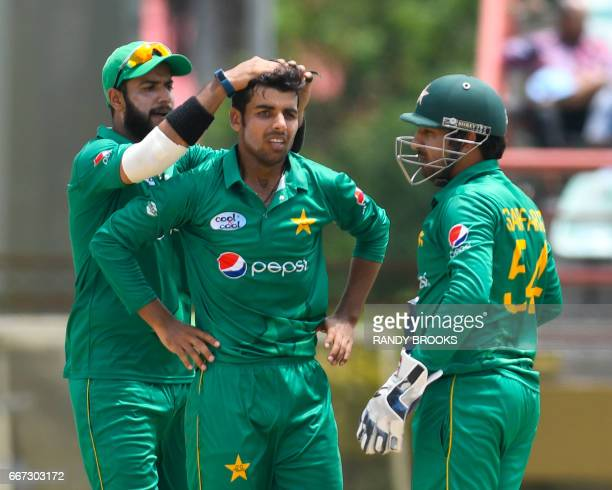 Imad Wasim Shadab Khan and Sarfraz Ahmed of Pakistan celebrate the dismissal of Jonathan Carter of West Indies during the 3rd and final ODI match...