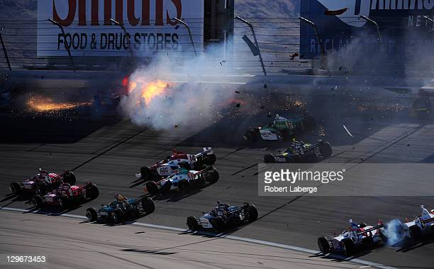 Image 10 in a sequence of 47 images of the crash in which Dan Wheldon of England driver of the Bowers Wilkins Sam Schmidt Motorsports Dallara Honda...