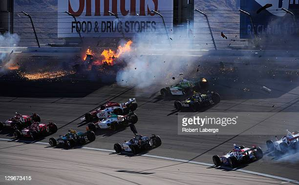 Image 11 in a sequence of 47 images of the crash in which Dan Wheldon of England driver of the Bowers Wilkins Sam Schmidt Motorsports Dallara Honda...