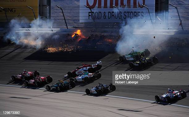 Image 12 in a sequence of 47 images of the crash in which Dan Wheldon of England driver of the Bowers Wilkins Sam Schmidt Motorsports Dallara Honda...