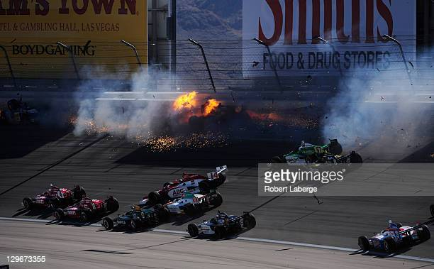 Image 13 in a sequence of 47 images of the crash in which Dan Wheldon of England driver of the Bowers Wilkins Sam Schmidt Motorsports Dallara Honda...