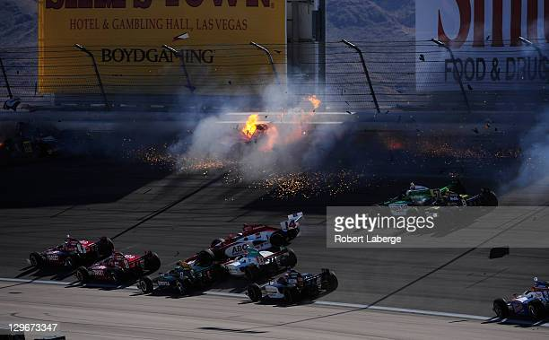 Image 14 in a sequence of 47 images of the crash in which Dan Wheldon of England driver of the Bowers Wilkins Sam Schmidt Motorsports Dallara Honda...