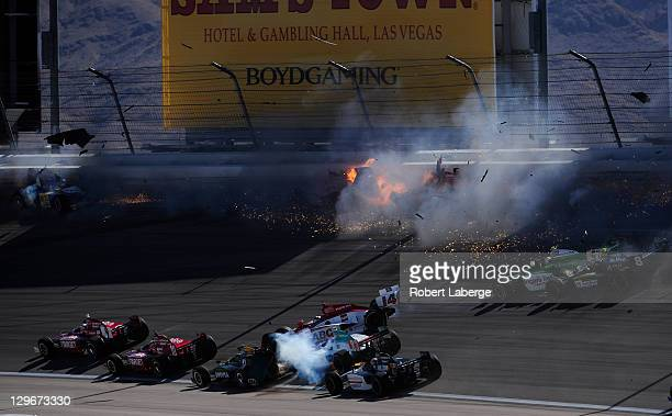 Image 15 in a sequence of 47 images of the crash in which Dan Wheldon of England driver of the Bowers Wilkins Sam Schmidt Motorsports Dallara Honda...