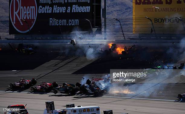 Image 18 in a sequence of 47 images of the crash in which Dan Wheldon of England driver of the Bowers Wilkins Sam Schmidt Motorsports Dallara Honda...