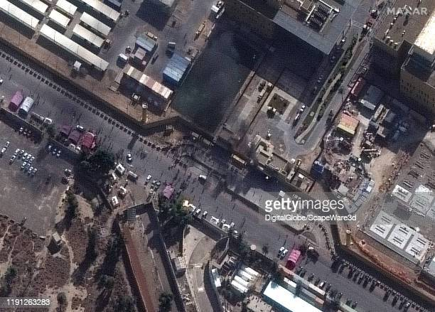 Image 2. Crowds and small fire at the western entrance of the United States Embassy compound in Baghdad, Iraq. Please use: Satellite image 2019 Maxar...