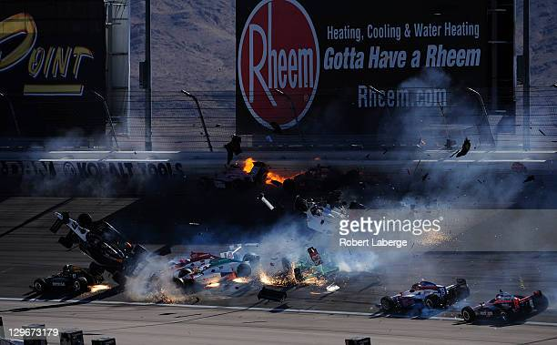 Image 20 in a sequence of 47 images of the crash in which Dan Wheldon of England driver of the Bowers Wilkins Sam Schmidt Motorsports Dallara Honda...