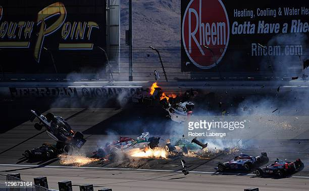 Image 21 in a sequence of 47 images of the crash in which Dan Wheldon of England driver of the Bowers Wilkins Sam Schmidt Motorsports Dallara Honda...