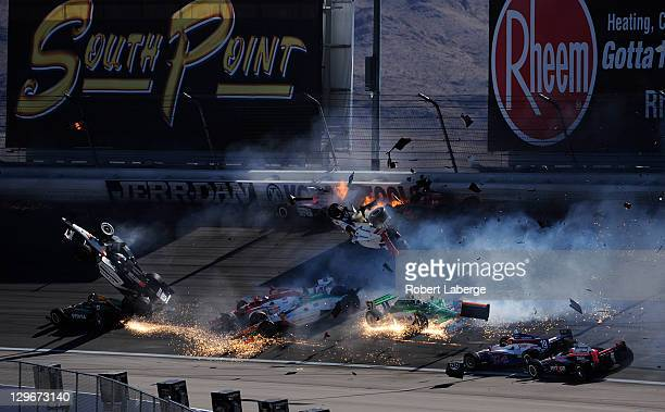 Image 22 in a sequence of 47 images of the crash in which Dan Wheldon of England driver of the Bowers Wilkins Sam Schmidt Motorsports Dallara Honda...