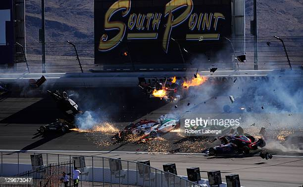 Image 24 in a sequence of 47 images of the crash in which Dan Wheldon of England driver of the Bowers Wilkins Sam Schmidt Motorsports Dallara Honda...