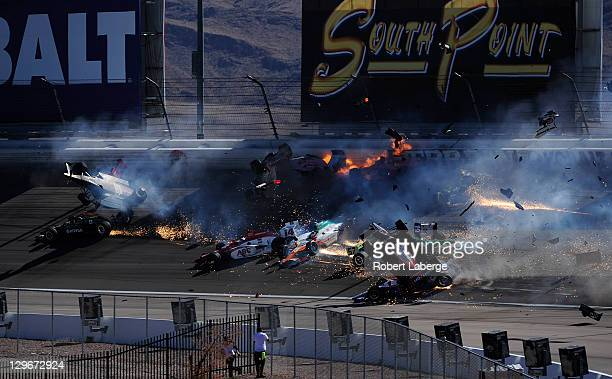 Image 26 in a sequence of 47 images of the crash in which Dan Wheldon of England driver of the Bowers Wilkins Sam Schmidt Motorsports Dallara Honda...