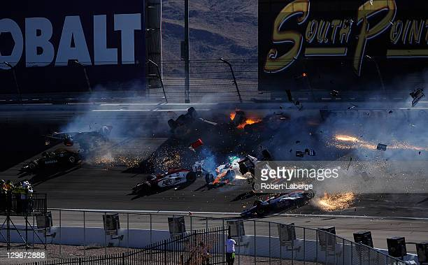 Image 27 in a sequence of 47 images of the crash in which Dan Wheldon of England driver of the Bowers Wilkins Sam Schmidt Motorsports Dallara Honda...