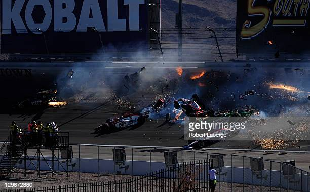 Image 28 in a sequence of 47 images of the crash in which Dan Wheldon of England driver of the Bowers Wilkins Sam Schmidt Motorsports Dallara Honda...