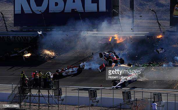 Image 29 in a sequence of 47 images of the crash in which Dan Wheldon of England driver of the Bowers Wilkins Sam Schmidt Motorsports Dallara Honda...