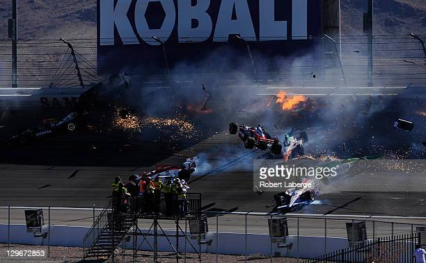 Image 30 in a sequence of 47 images of the crash in which Dan Wheldon of England driver of the Bowers Wilkins Sam Schmidt Motorsports Dallara Honda...