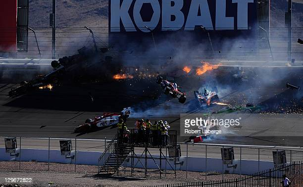 Image 31 in a sequence of 47 images of the crash in which Dan Wheldon of England driver of the Bowers Wilkins Sam Schmidt Motorsports Dallara Honda...
