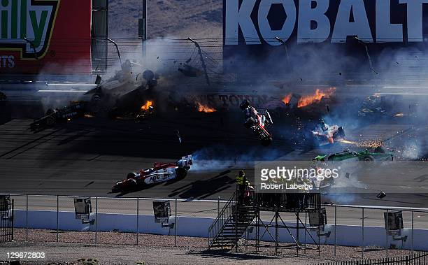 Image 32 in a sequence of 47 images of the crash in which Dan Wheldon of England driver of the Bowers Wilkins Sam Schmidt Motorsports Dallara Honda...