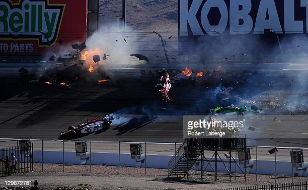 Image 33 in a sequence of 47 images of the crash in which Dan Wheldon of England driver of the Bowers Wilkins Sam Schmidt Motorsports Dallara Honda...